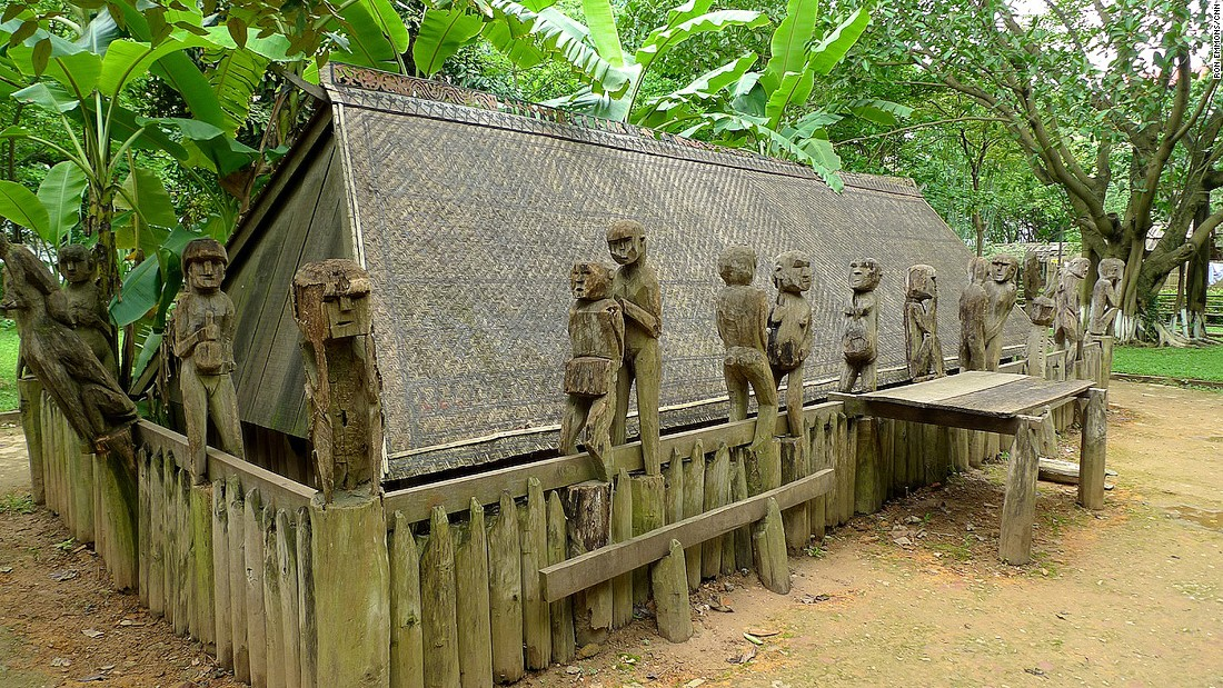 Prized possessions such as a TV or bicycle may be laid to rest with the dead, Simple wooden carvings of figures are placed on the boundary of the grave. This Giarai tomb is part of the Vietnam Museum of Ethnology in Hanoi.