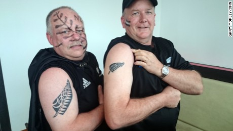 Craig Lockwood (left) and Grant Duder show off their tattoos.