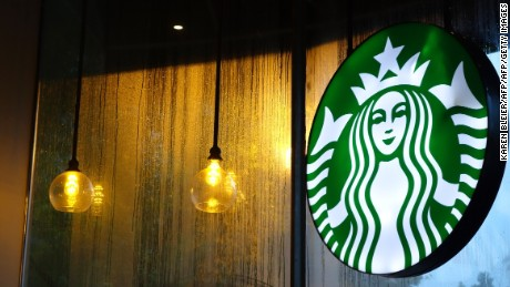 A sign for Starbucks is seen August 11, 2015 in Washington, DC. AFP PHOTO / KAREN BLEIER        (Photo credit should read KAREN BLEIER/AFP/Getty Images)
