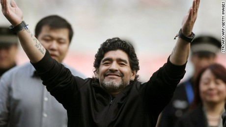 Argentine football star Diego Maradona poses as he takes part in a charity match organised by the Chinese Red Cross Foundation in Jinan, east China's Shandong province on November 5, 2010. Maradona is in China for a charity tour to raise money for a Chinese Red Cross Foundation project aimed at helping poor people who suffer from cancer. CHINA OUT AFP PHOTO        (Photo credit should read STR/AFP/Getty Images)