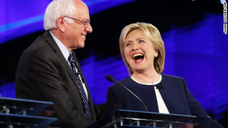 Sen. Bernie Sanders, of Vermont, left, and Hillary Rodham Clinton laugh during the CNN Democratic presidential debate Tuesday, Oct. 13, 2015, in Las Vegas. (AP Photo/John Locher)