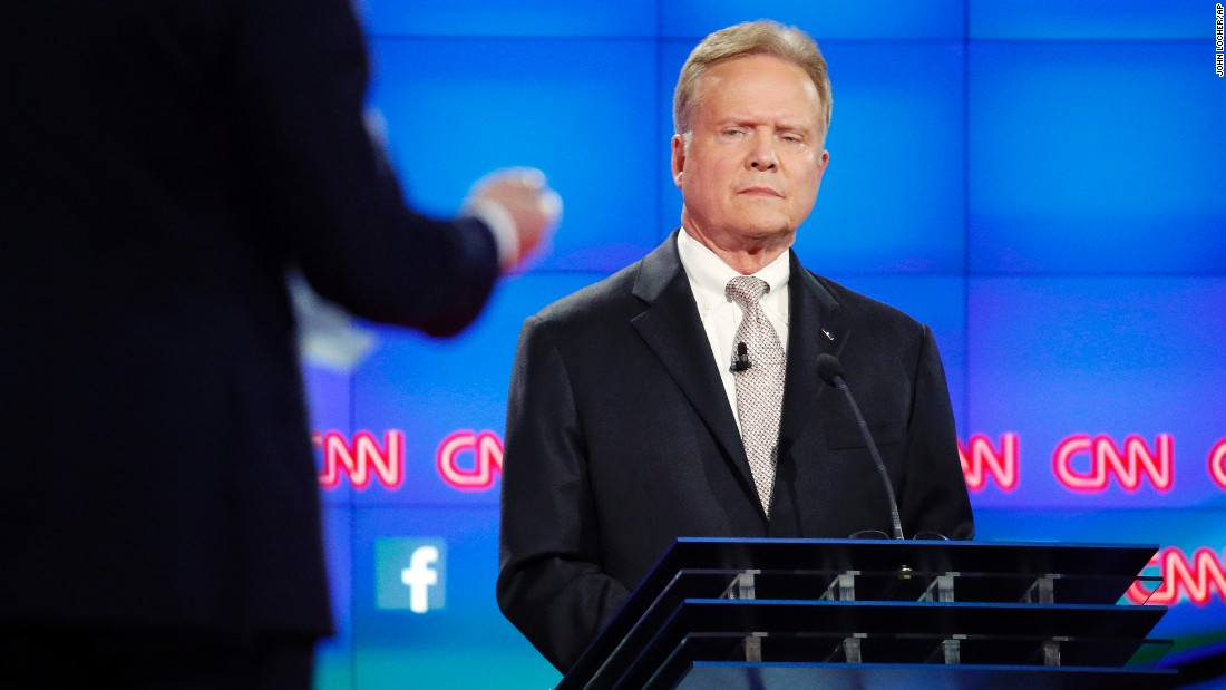 """Webb listens to moderator Anderson Cooper during the debate. Webb is a former Marine who also served as secretary of the U.S. Navy. """"You may be sure that in a Webb administration, the highest priority will be the working people who every day go out and make this country stronger at home, and who give us the right reputation and security overseas under a common-sense foreign policy,"""" Webb said."""