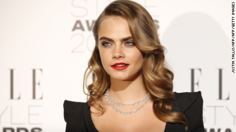 British model Cara Delevingne poses for photographers on the red carpet to attend the ELLE Style Awards 2015 in London on February 24, 2015. The ELLE Style Awards are the official closing party of London Fashion Week. AFP PHOTO / JUSTIN TALLIS        (Photo credit should read JUSTIN TALLIS/AFP/Getty Images)
