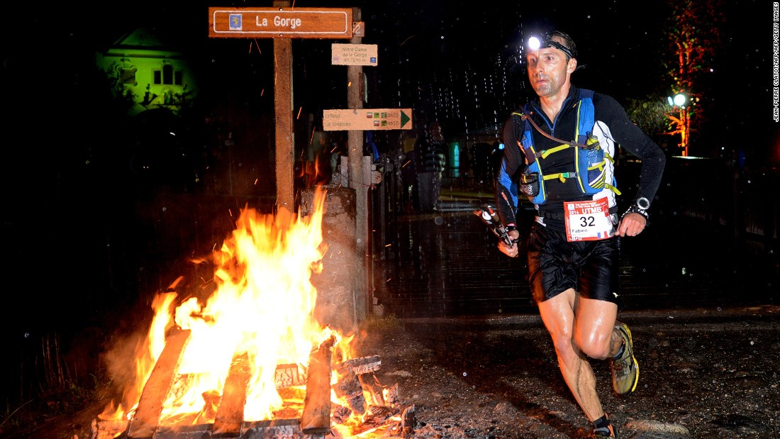 Running through the night, competitors in the Ultra Marathon Mont Blanc will have to negotiate seven valleys, 71 glaciers and 400 summits -- plus 9,400 meters of altitude.<br />