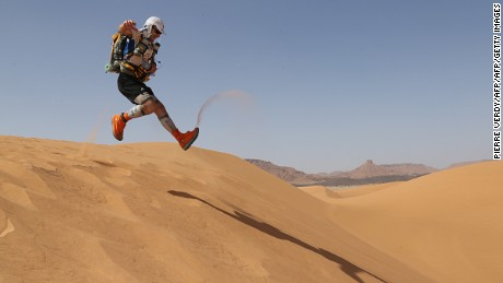 "A competitor runs on a dune, on April 10, 2013, during the 28th edition of the ""Marathon des Sables"", some 300 kms south of Ouarzazate. The 223,8 kms Desert Marathon is considered as the hardest in the world. About 1024 participants, from 45 nationalities and aged 20 to 76, have to walk during seven days in the Moroccan Sahara and carry all their equipment and food on their backs.  AFP PHOTO / PIERRE VERDY        (Photo credit should read PIERRE VERDY/AFP/Getty Images)"