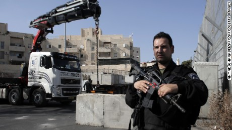 Israeli security forces gather at the site where a road block is being set up on a road close to the Palestinian neighbourhood of Ras al-Amud  in east Jerusalem, on October 14, 2015. Israel set up checkpoints in Palestinian neighbourhoods of east Jerusalem and mobilised hundreds of soldiers as it struggled to stop  attacks that have raising fears of a full-scale uprising.  AFP PHOTO / AHMAD GHARABLI        (Photo credit should read AHMAD GHARABLI/AFP/Getty Images)
