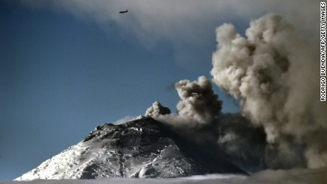 Picture taken from Quito (45 km) of the Cotopaxi volcano spewing ash on October 09, 2015.  The volcano is considered one of the world's most dangerous because its snow cap is vulnerable in an eruption and because of its close proximity to densely populated areas. AFP PHOTO / RODRIGO BUENDIA        (Photo credit should read RODRIGO BUENDIA/AFP/Getty Images)