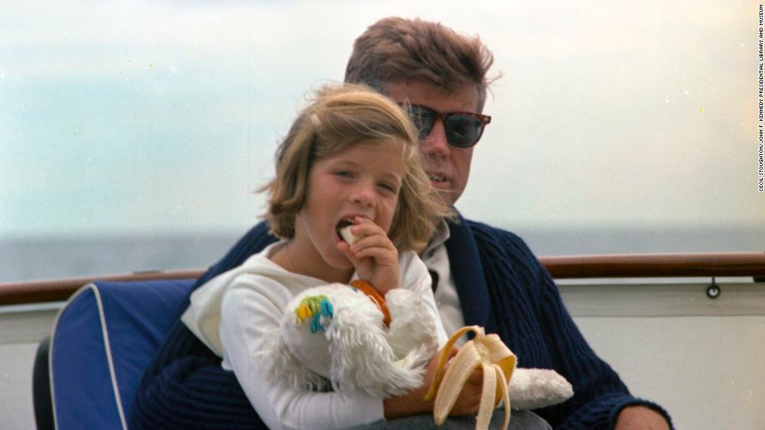 Kennedy with daughter Caroline off the coast of Hyannis Port, Massachusetts.