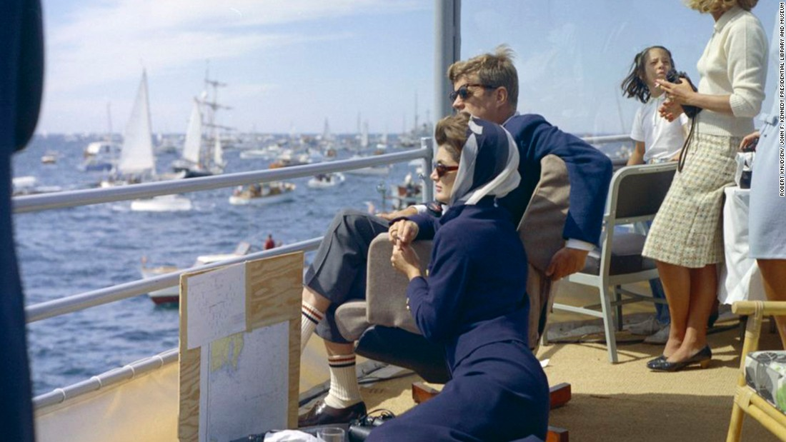 Kennedy and Jacqueline watch the first race of the 1962 America's Cup off Newport, Rhode Island.