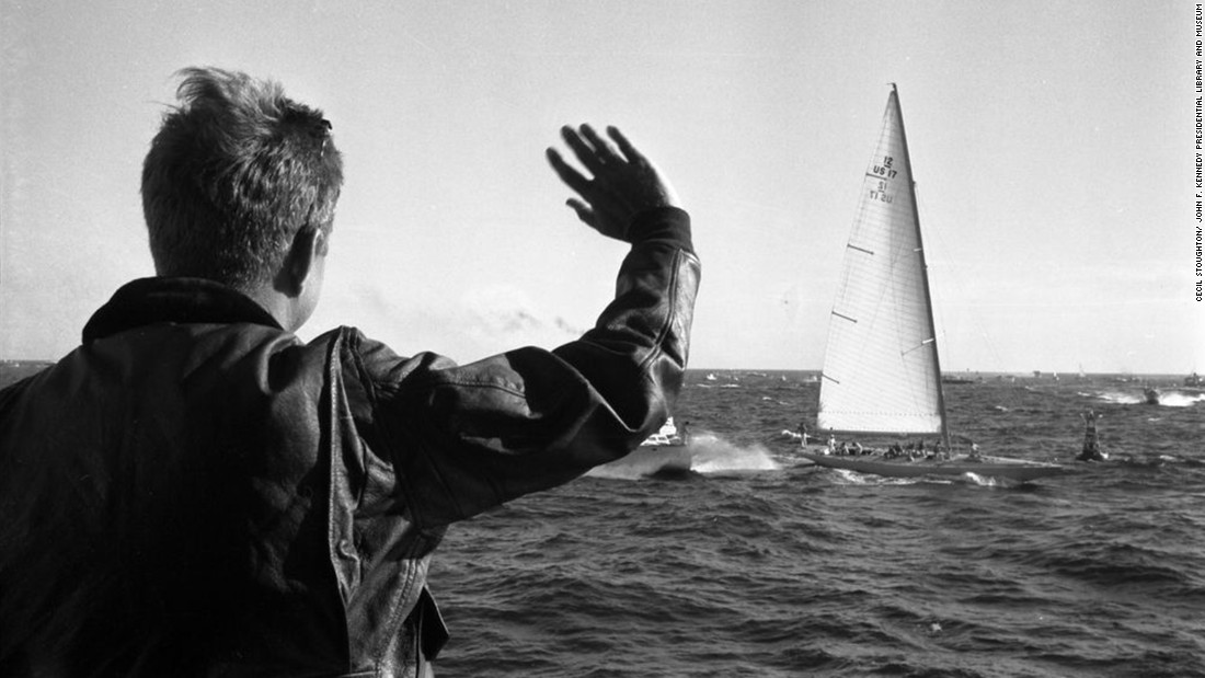 President John F. Kennedy watches the first race of the 1962 America's Cup off the coast of Newport, Rhode Island.