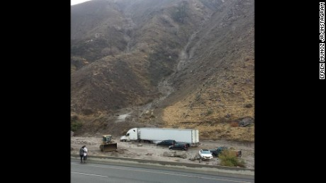 "Efren Munoz Jr. took this photo Thursday when he became stuck in mud on Interstate 5 in the Tehachapi Mountains, a highway known locally as ""the grapevine."""