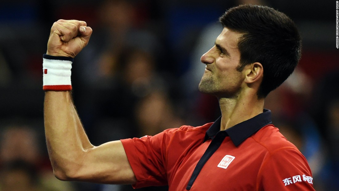Novak Djokovic  celebrates after winning his semi-final match against Andy Murray at the Shanghai Masters.