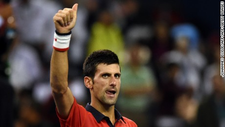 Novak Djokovic of Serbia celebrates after winning his men's singles semi-final match against Andy Murray of Britain at the Shanghai Masters tennis tournament in Shanghai on October 17, 2015.