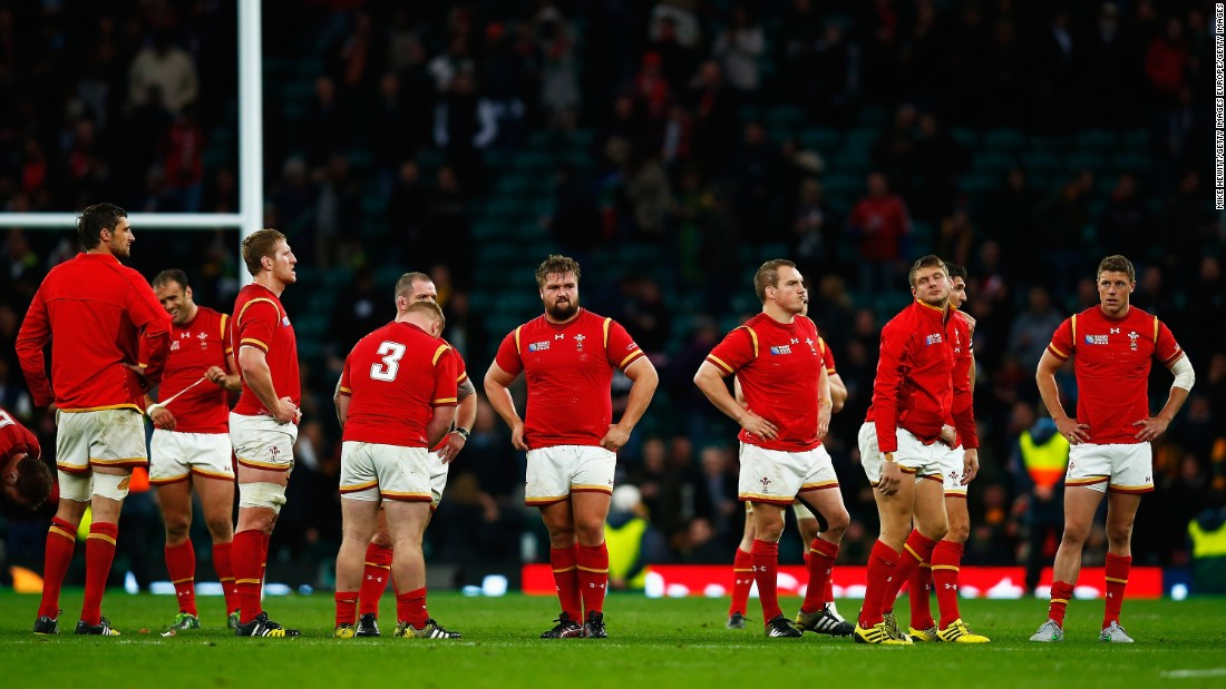 The Wales team look dejected at the full time whistle.