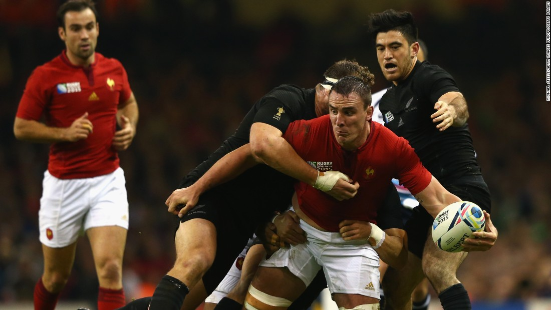 Louis Picamoles of France is tackled by Wyatt Crockett of the New Zealand All Blacks (L) and Nehe Milner-Skudder of New Zealand.