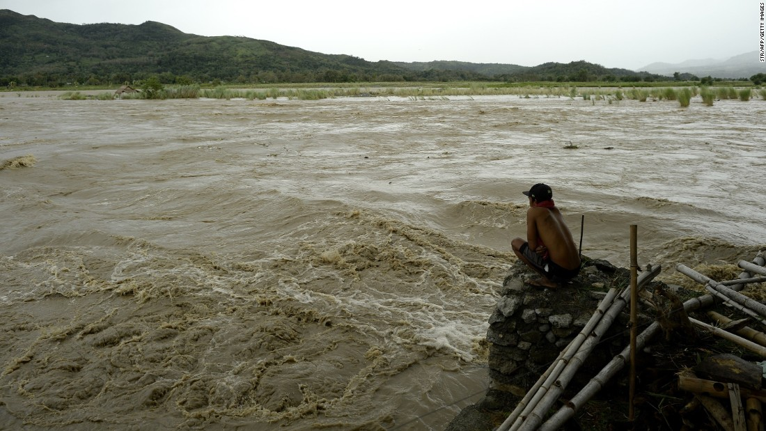 A man looks at the rising water of the Magat River in Bayombong on October 18.