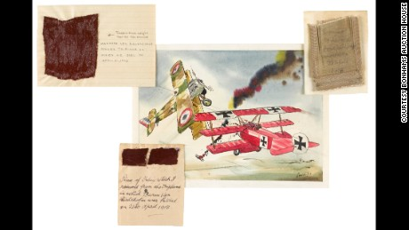 Manfred von Richthofen's plane is downed in an artist's rendering, center, surrounded by swatches of fabric from his Fokker triplane.