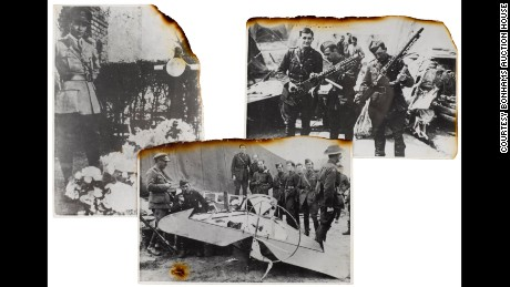 Allied soldiers show off items from Manfred von Richthofen, including his fallen plane, bottom.