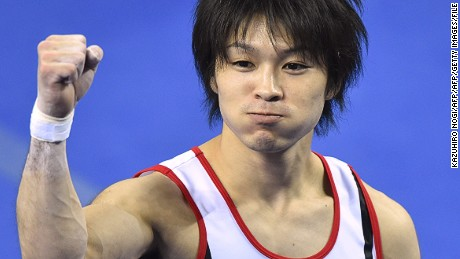 Japan's Kohei Uchimura reacts after his performance on the horizontal bar during the men's all-around final at the gymnastics world championships in Nanning on October 9, 2014. Uchimura wins fifth world all-around title.    AFP PHOTO/KAZUHIRO NOGI        (Photo credit should read KAZUHIRO NOGI/AFP/Getty Images)