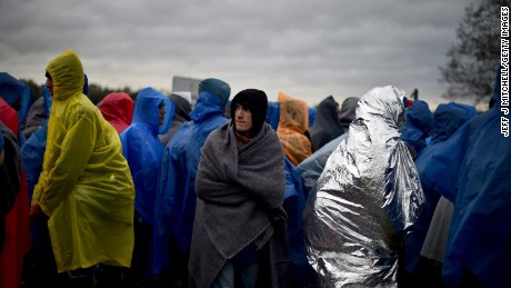 TRNOVEC, CROATIA - OCTOBER 19:  Migrants wait in the rain at the Trnovec border crossing as restrictions on movements through have produced bottlenecks on Croatias borders on October 19, 2015 in Trnovec ,Croatia. Slovenian authorities closed the border after reaching their daily quota, leaving over 1000 migrants stranded as hundreds more continue to arrive.  (Photo by Jeff J Mitchell/Getty Images)
