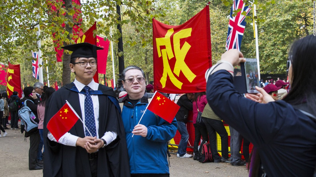 China supporters pose for a picture in London on October 20.