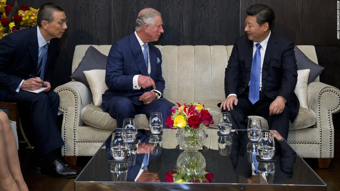 Prince Charles talks with Xi at a London hotel on October 20.