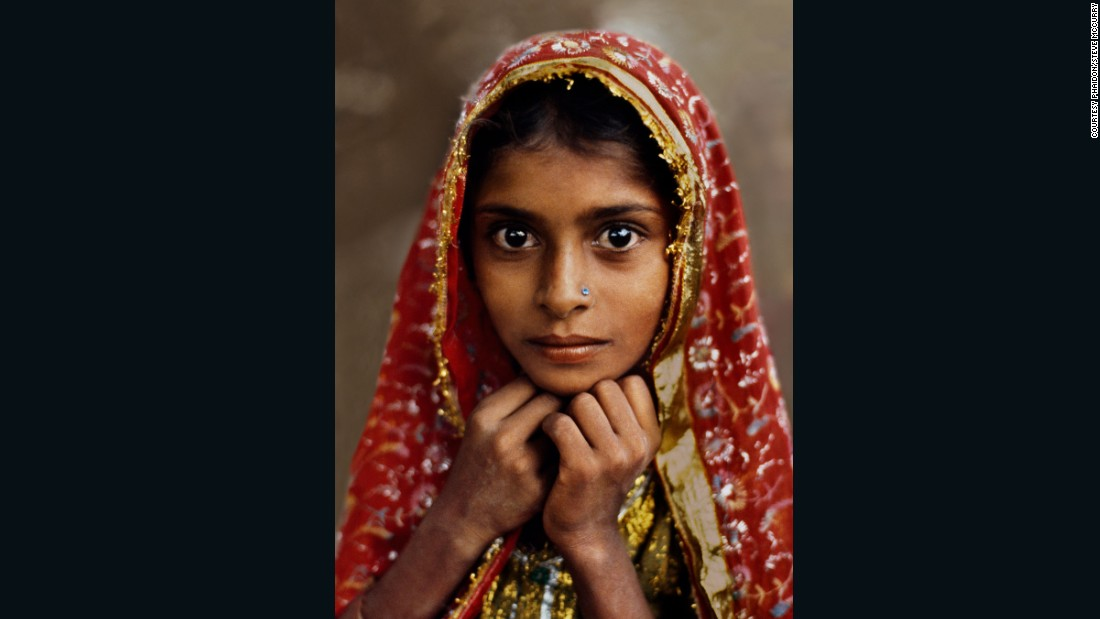 "McCurry's most famous image is undoubtedly his portrait of an ""Afghan Girl"" which graced the cover of National Geographic in 1985.<br /><br />It's not so dissimilar to this striking portrait of a ""Girl in Red,"" taken in Jaipur, Rajasthan, in 1983.<br /><br /><br />"