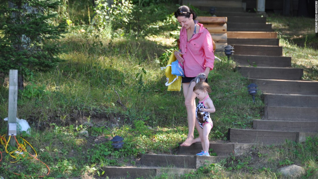 In August 2011, Coglianese was still undiagnosed, but began to fall for no reason, it seemed. Here, she and her daughter carefully navigate the stairs at her uncle's lake house.
