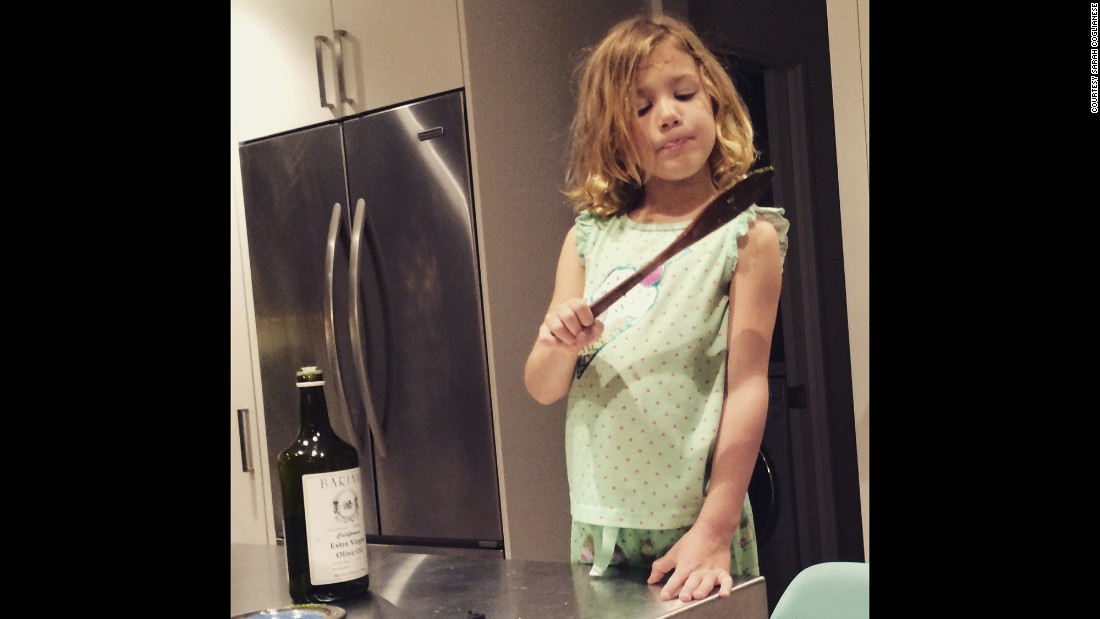 Cooking is one of Scarlett's favorite activities. She's seen here licking the spoon after making pesto sauce.