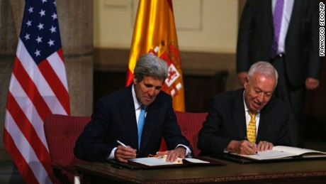 U.S. Secretary of State John Kerry, left, and Spanish Foreign Minister Jose Manuel Garcia Margallo sign agreements Monday, October 19, relating to the cleanup of the Palomares disaster of 1966.