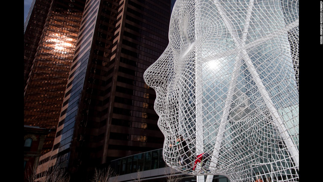 "The 12-meter ""Wonderland"" sculpture by Spanish artist Jaume Plensa has been a fixture in downtown Calgary since 2013. His other works include ""Crown Fountain"" in Chicago and ""House of Knowledge"" in Boras, Sweden."