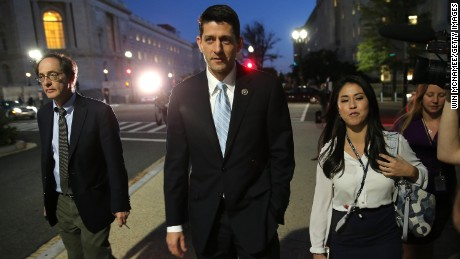 U.S. Rep. Paul Ryan (C) walks to the U.S. Capitol for a series of votes and a meeting with House Republicans October 20, 2015 in Washington, DC.