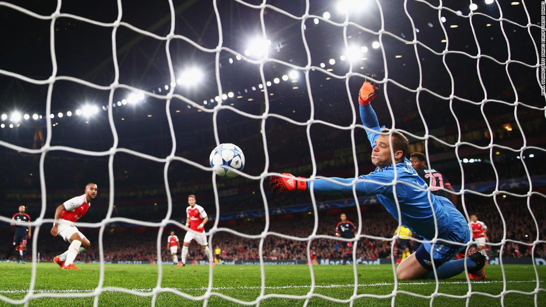 Manuel Neuer of Bayern Munich makes a save from Theo Walcott of Arsenal during the UEFA Champions League Group F match between Arsenal FC and FC Bayern Munchen at Emirates Stadium.