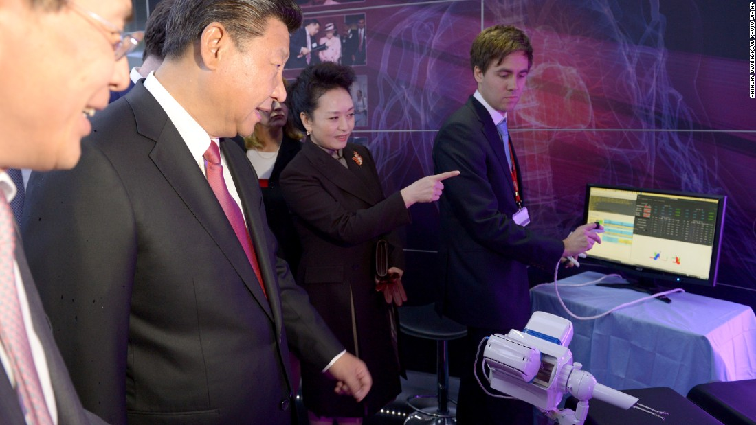 Xi and Peng inspect equipment at Imperial College's Hamlyn Centre for Medical Robotics.