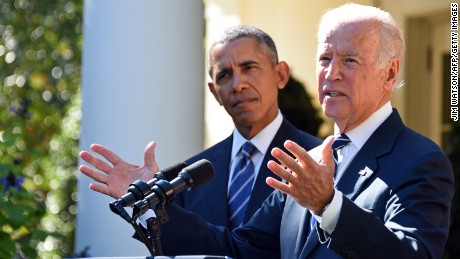 US Vice President Joe Biden (R), flanked by US President Barack Obama (L), speaks in the Rose Garden at the White House on October 21, 2015, in Washington, DC. Biden announced that he is not running for president. AFP PHOTO / JIM WATSON        (Photo credit should read JIM WATSON/AFP/Getty Images)