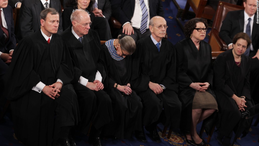 "Supreme Court Justice Ruth Bader Ginsburg (C) fell asleep during Barack Obama's State of the Union speech in January 2015. It wasn't the first time, she says. The reason? ""I was not 100% sober,"" Ginsburg said, blaming fellow Justice Anthony Kennedy for bringing a bottle of red wine to their pre-speech dinner."