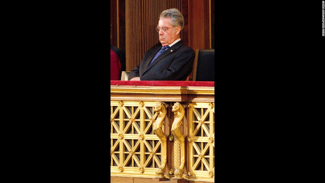 Austrian President Heinz Fischer conserves his energy during a commemoration ceremony against violence and racism in Parliament in May 2012.