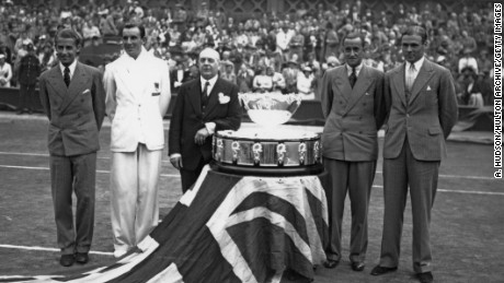 The British team with the trophy on the Centre Court at Wimbledon after retaining the Davis Cup, London, 28th July 1936. Left to right: Bunny Austin (1906 - 2000), Fred Perry (1909 - 1995), Raymond Tuckey (1910 - 2005) and Pat Hughes (1902 - 1997). (Photo by A. Hudson/Topical Press Agency/Hulton Archive/Getty Images)