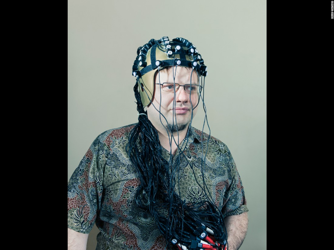 "Shown here wearing a helmet outfitted with electrical coils,Vladimirov told CNN he has no problem being called a ""brain hacker."" He says he likes Hollywood's X-Men movie franchise, which is about evolving humans. He finds the X-Men films ""quite useful in promoting our cause."""