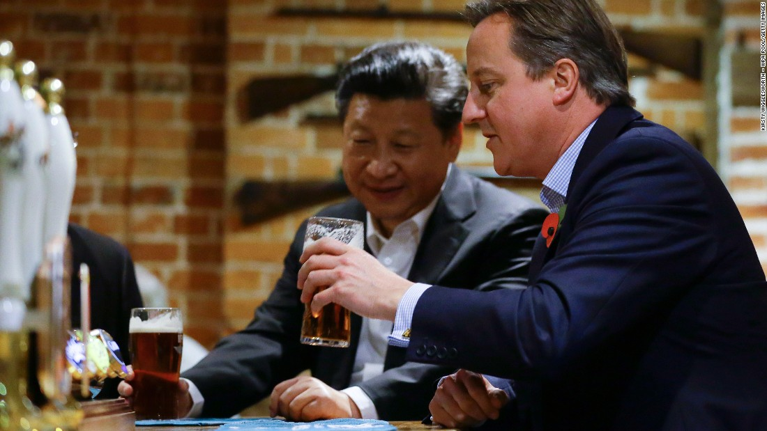 Cameron drinks a pint of beer with Xi at a pub in Princes Risborough, England, on Thursday, October 22.
