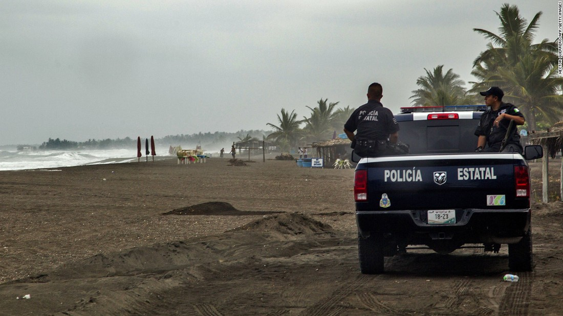 Police patrol the beach in Boca de Pascuales on October 22.