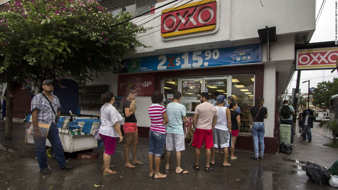 People line up to buy food and water in Puerto Vallarta on October 23.