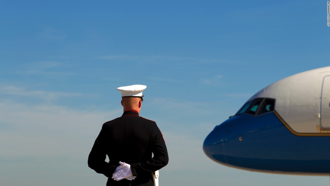 A U.S. Marine stands at attention as Air Force One prepares to depart Andrews Air Force Base in Maryland on Wednesday, October 21.