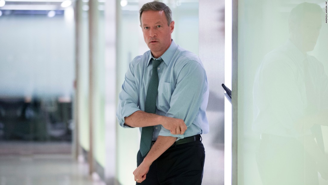 Democratic presidential candidate Martin O'Malley rolls up his sleeves Wednesday, October 21, as he arrives to host an event at the Microsoft Innovation & Policy Center in Washington.