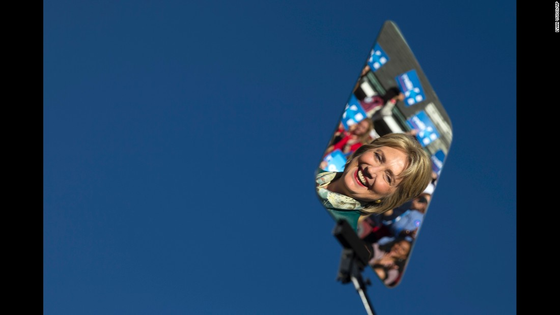 Hillary Clinton is reflected on a teleprompter during a campaign rally in Alexandria, Virginia, on Friday, October 23.