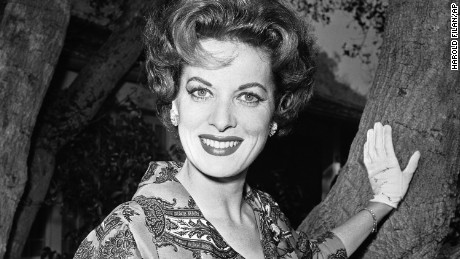 "FILE - This Jan. 19, 1960 file photo shows movie actress Maureen O'Hara photographed in her front yard in Los Angeles. O'Hara,who appeared in such classic films as ""The Quiet Man and How Green Was My Valley,"" has died. Her manager says OHara died in her sleep Saturday, Oct. 24, 2015 at her home in Boise, Idaho.  (AP Photo/Harold Filan,File)"