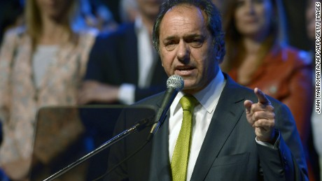 Buenos Aires Governor Daniel Scioli deliveris a speech during the closing of the election campaign of Argentinian Mayor of Lomas de Zamora and candidate for Deputy for the ruling Frente para la Victoria party, Martin Insaurralde (out of frame), in Lomas de Zamora, Buenos Aires province, on October 24, 2013. Argentina will hold parlamentary elections next October 27. AFP PHOTO AFP PHOTO / JUAN MABROMATA        (Photo credit should read JUAN MABROMATA/AFP/Getty Images)