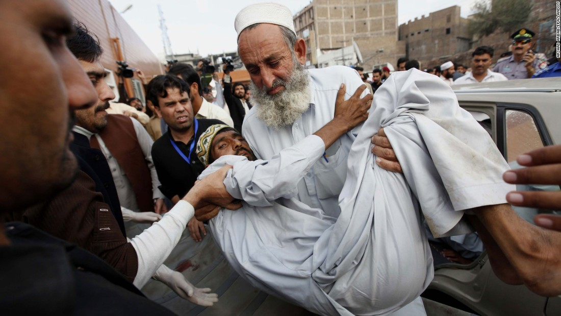 A man is carried to a hospital in Peshawar on Monday, October 26.