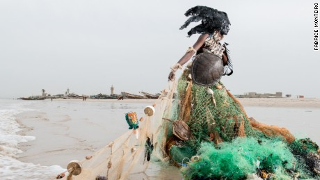 The costumes turn garbage into gowns. This dress is made of fishing nets.
