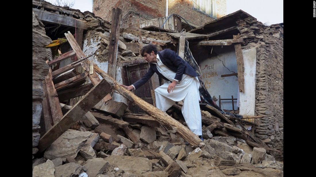 A man sifts through the rubble of a house in Mingora, Pakistan, on Tuesday, October 27. A magnitude-7.5 earthquake struck near Jarm, Afghanistan, along the Afghanistan-Pakistan border, on Monday.